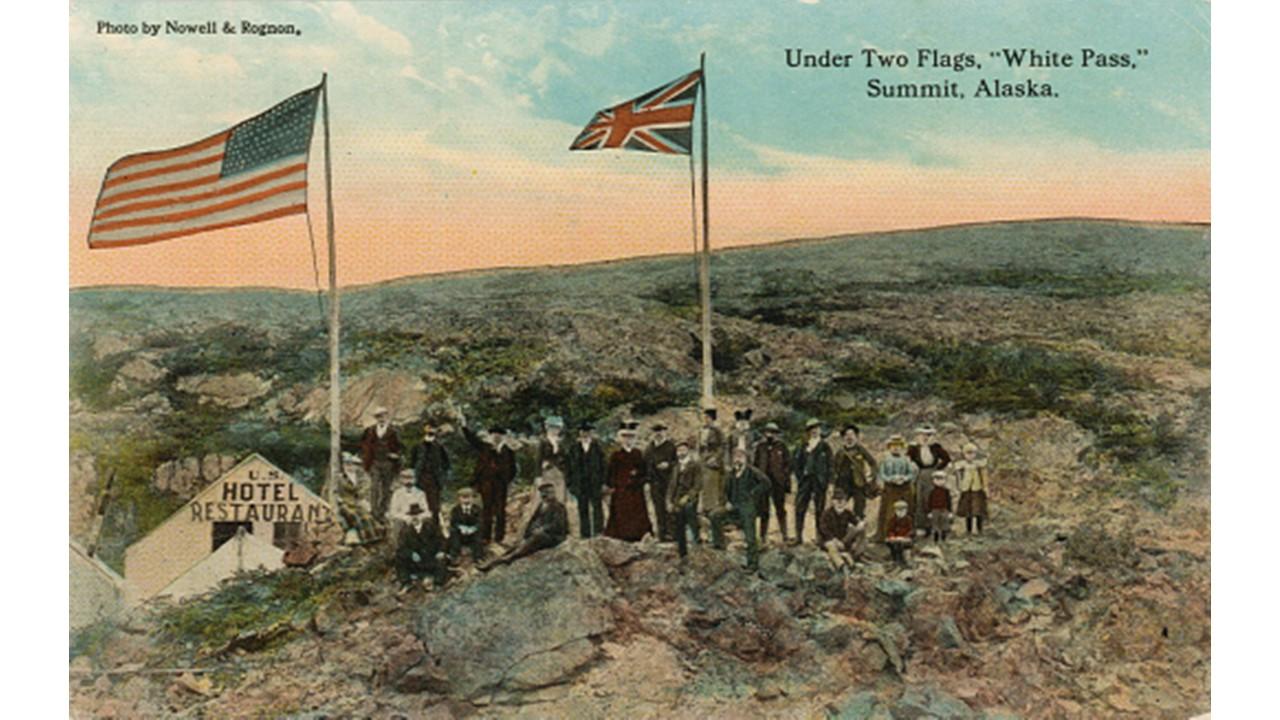 A postcard, circa 1907, entitled Under Two Flags, White Pass Summit, Alaska. Photo courtesy of the author, Dr. Preston Jones.
