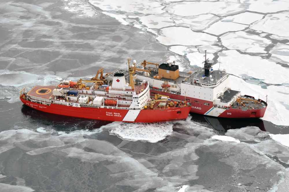 The Canadian Coast Guard icebreaker Louis S. St-Laurent makes an approach to the US Coast Guard Cutter Healy in the Arctic Ocean in September 2009. Photo by Petty Officer Patrick Kelley, US Coast Guard.